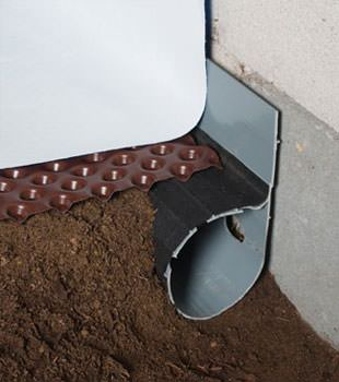 Closeup of a crawl space drainage system installed in North Little Rock