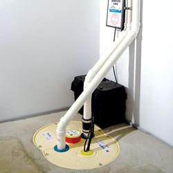 A complete sump pump and battery backup system installed in a home in Bryant