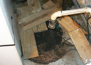 An ugly, clogged sump pump system in Greenbrier, Arkansas