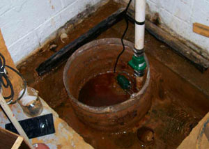 Extreme clogging and rust in a Bigelow sump pump system