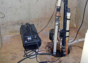 Pedestal sump pump system installed in a home in Traskwood