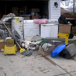 Soaked, wet personal items sitting in a driveway, including a washer and dryer in Greenbrier.