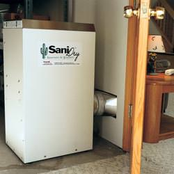 A basement dehumidifier with an ENERGY STAR® rating ducting dry air into a finished area of the basement  in Little Rock