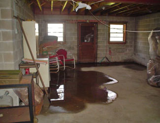 a flooded basement floor in a Little Rock home