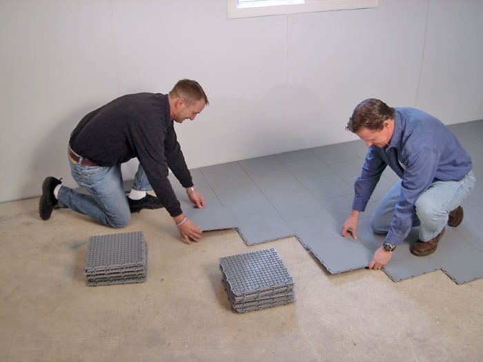 Contractors Installing Bat Subfloor Tileatting On A Concrete Floor In Maumelle Arkansas